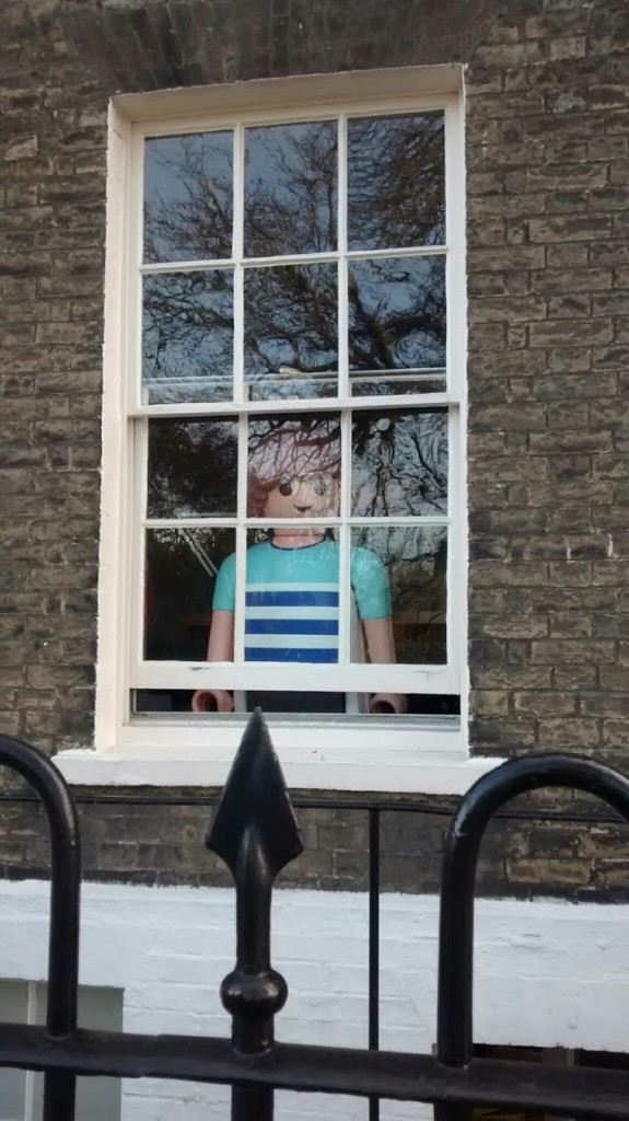 giant playmobil figure in window